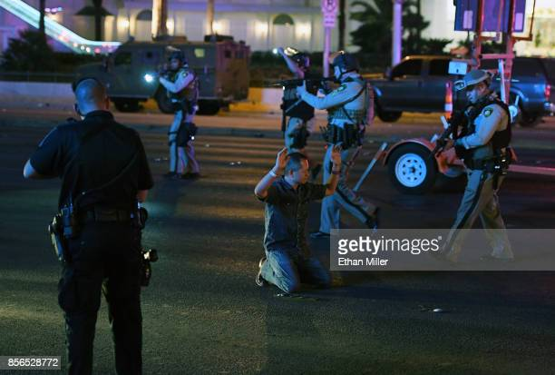 Police officers stop a man who drove down Tropicana Ave near Las Vegas Boulevard and Tropicana Ave which had been closed after a mass shooting at a...