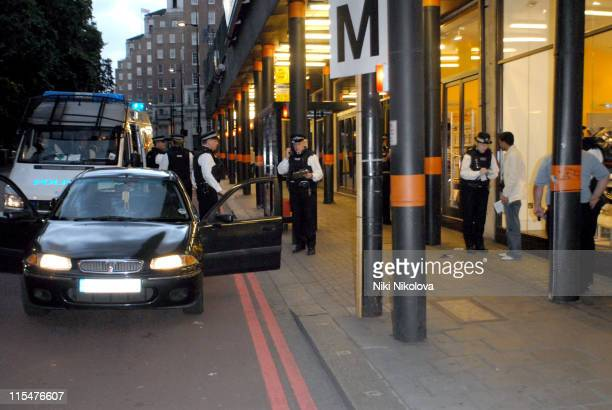 Police Officers stop and search a group of men driving in a black car down Park Lane London at 2100 London is on alert after several car bomb devices...