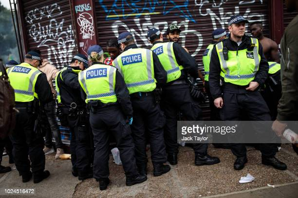 Police officers stop and search people on the final day of the Notting Hill Carnival on August 27, 2018 in London, England. The Notting Hill...