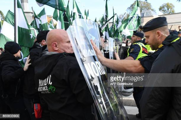 Police officers stop the farright Nordic Resistance Movement march as it tries to change the planned route on September 30 2017 in Gothenburg Sweden...