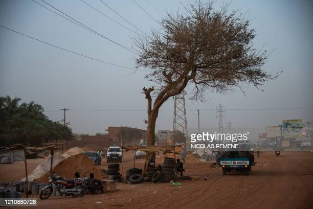 Police officers, supported by a team of municipal officers, continue to collect tires in the 5 districts of the city in Niamey on April 23 on the eve...