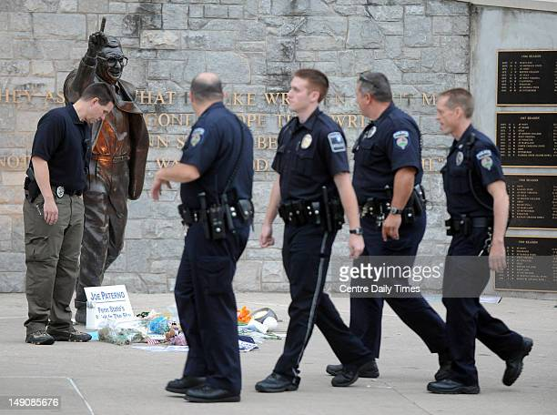 Police officers surround the Joe Paterno statue before its removal outside of Beaver Stadium on Sunday July 22 in State College Pennsylvania