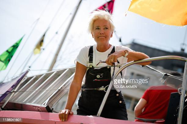 Police officers surround the pink boat being used as a stage by climate change activists including British actress Emma Thompson as they occupy the...