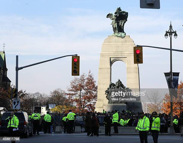 Police officers surround the War Memorial Monument as people lay poppies on Tomb of the Unknown Soldier after this morning's Remembrance Day ceremony...