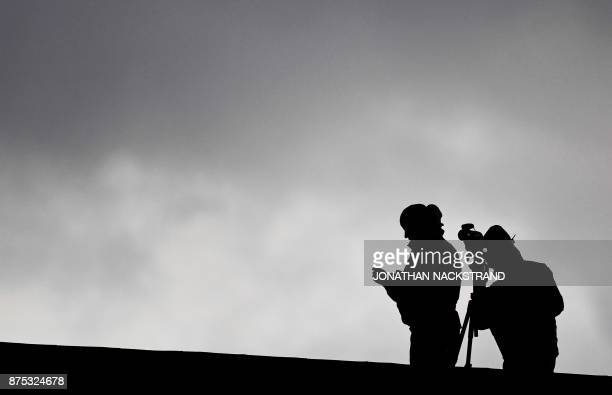 Police officers surveil the area from the rooftop of the restaurant where the luncheon takes place during the European Social Summit in Gothenburg...