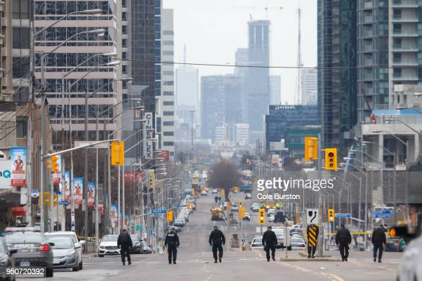 Police officers sweep Yonge St on April 24 2018 in Toronto Canada A suspect identified as Alek Minassian is in custody after a driver in a white...