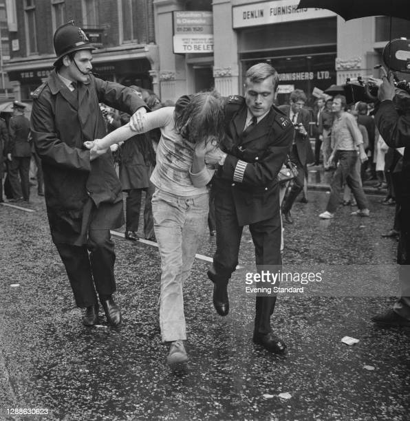 Police officers tackling a protestor during a demonstration against the Oz magazine obscenity trial in London, UK, 1971.