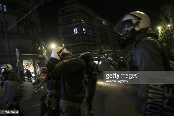 Police officers take a demonstrators into custody during the 43rd anniversary of student uprising against Greek dictatorship in 1973 in Athens Greece...