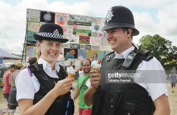 Police Officers take a moment to enjoy an icecream in the sunshine on day one of Glastonbury Festival at Worthy Farm on June 24 2010 in Glastonbury...