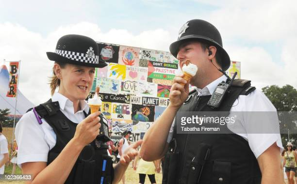 Police Officers take a moment to enjoy ice cream in the sunshine on day one of Glastonbury Festival at Worthy Farm on June 24 2010 in Glastonbury...