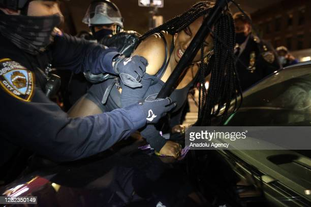 Police officers take a protester into custody as hundreds of BLM protesters are gathered at the Barclays Center and take streets for 13 years old...