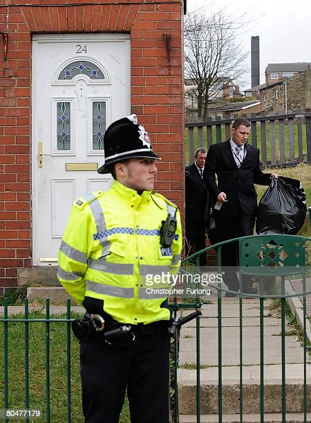 Police Officers take away bags from the home of Karen Matthews the mother of Shannon Matthews and her boyfriend Craig Meehan in Moorside Road...