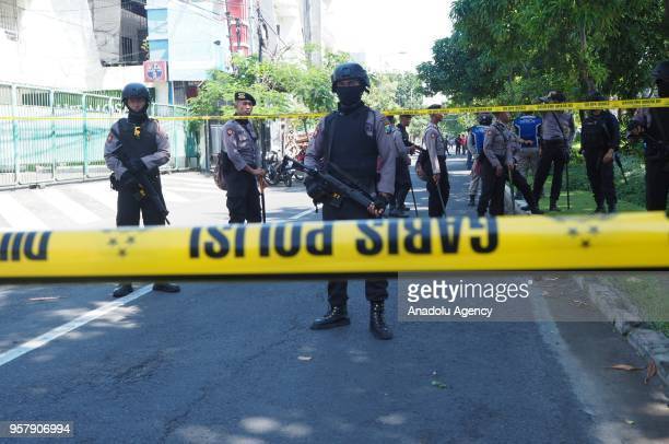Police officers take security measures after a bomb blasted at The Immaculate Santa Maria Church in Surabaya Indonesia on May 13 2018 Three suicide...