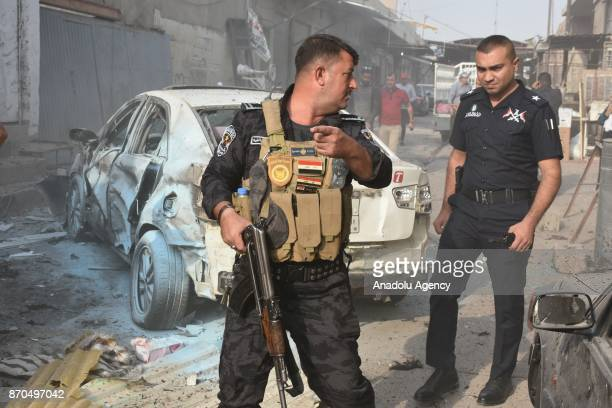 Police officers take security measures after a suicide bomber detonated his explosive vest in Atlas street in Kirkuk Iraq on November 05 2017 Twin...