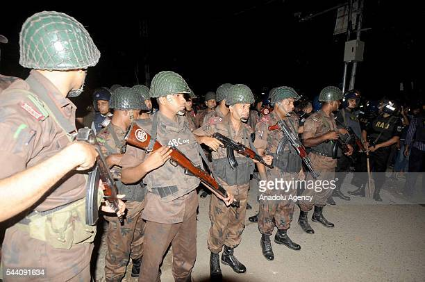 Police officers take security measures after armed attackers attack to a restaurant in Dhaka Bangladesh on July 1 2016