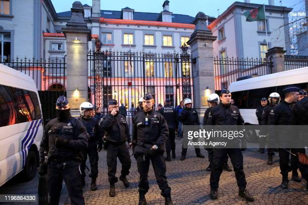 Police officers take security measures as environmentalists stage a protest against briefing meeting on World Economic Forum to be held in Brussels...