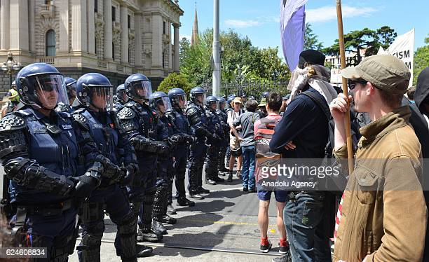 Police officers take security measures as people stage a protest against Presidentelect Donald Trump of Republican Party in Melbourne Australia on...
