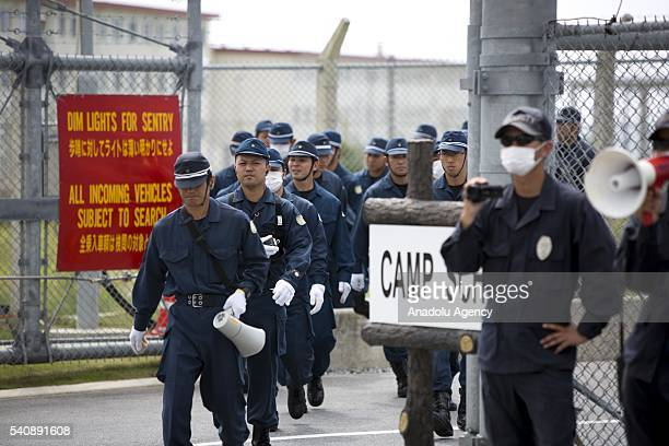 Police officers take security measures as People stage a rally against past incident of rape of a Japanese woman and drunk driving in Okinawa over...