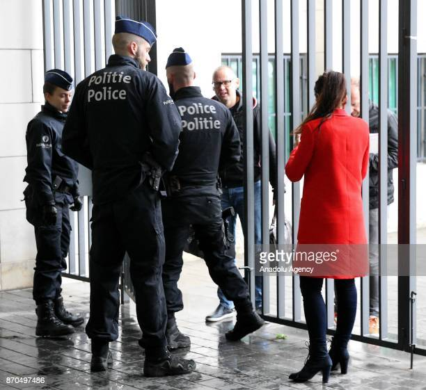 Police officers take security measures as the spokesperson for the Belgian Prosecutors Office Gilles Dejemeppe holds a press conference at the public...