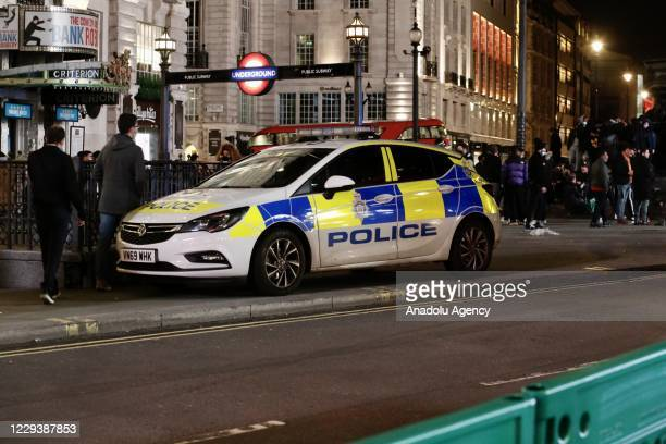 Police officers take security measures during Halloween celebrations in London, United Kingdom on November 01, 2020. People dress and use make-up to...