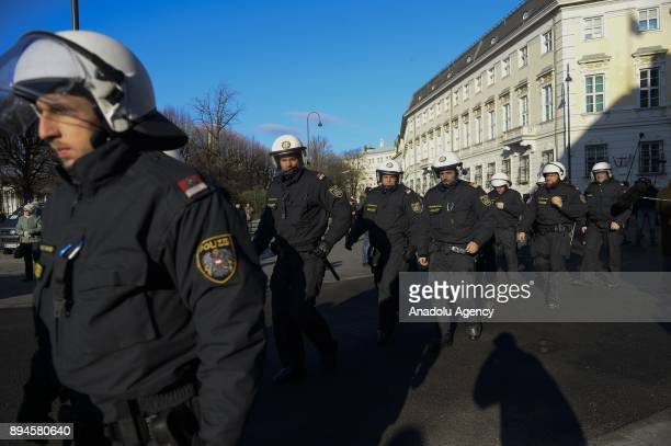 Police officers take security measures during the swearingin ceremony at the Hofburg Palace in Vienna Austria on December 18 2017 The Austrian...