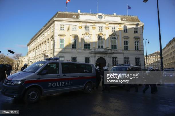 Police officers take security measures during the swearingin ceremony in front of the Hofburg Palace in Vienna Austria on December 18 2017 The...