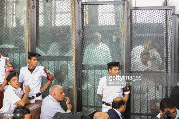 Police officers take security measures during the trial session, known as breaking up the Rabaa el-Adaweya protests case, at Cairo criminal court in...