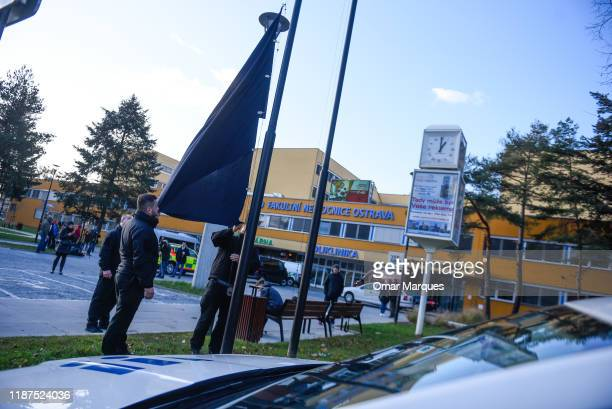 Police officers take security measures outside the Ostrava Teaching Hospital after a shooting incident on December 10, 2019 in Ostrava, Czech...
