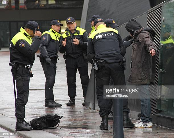 Police officers take some protesters into custody during a protest of PEGIDA in Rotterdam Netherlands on November 29 2015