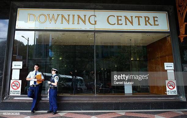 Police officers talk in front of the Downing Centre local courts on February 19 2015 in Sydney Australia Court officials are refusing to comment...
