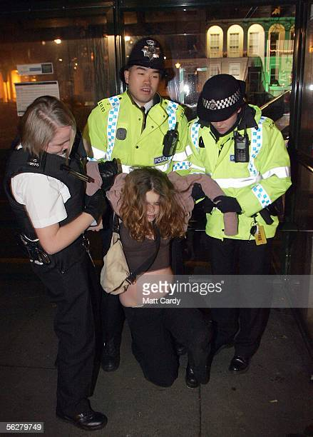 Police officers talk with a woman found slumped intoxicated as part of an operation to enforce the new licensing laws and clampdown on alcohol...