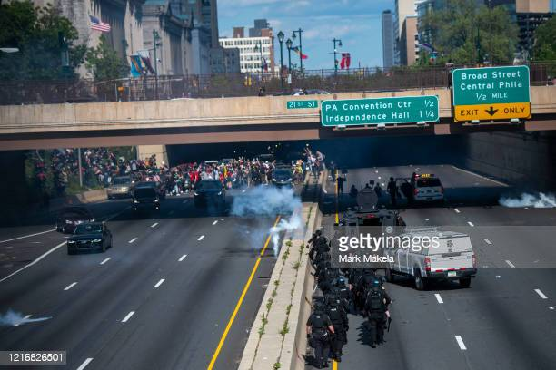 Police officers throw and shoot tear gas into a group of protesters after a march through Center City on June 1 2020 in Philadelphia Pennsylvania...