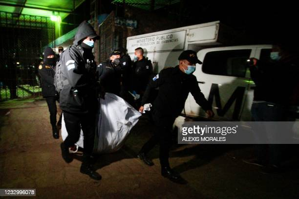 Police officers transport the corpse of one inmate after a brawl in Cantel men's prison in Quetzaltenango department 205km west of Guatemala City on...
