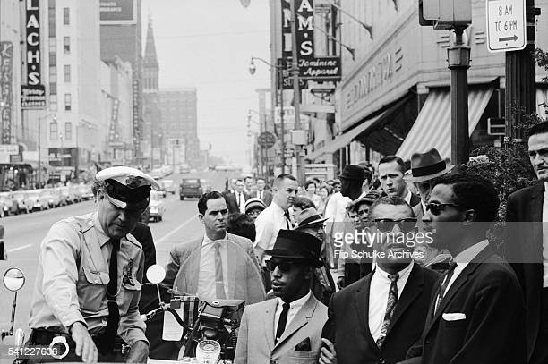 Police officers try to block civil rights activists picketing in downtown Birmingham against segregation