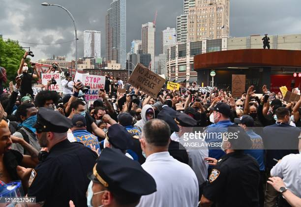 Police officers try to block protesters gathered during a Black Lives Matter protest near Barclays Center on May 29 2020 in the Brooklyn borough of...