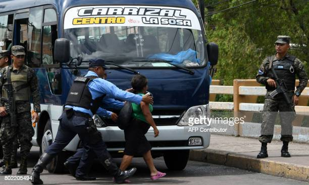 Police officers try to control a woman whose son a bus driver was killed by gang members for refusing to pay them a war tax over Soberania bridge...
