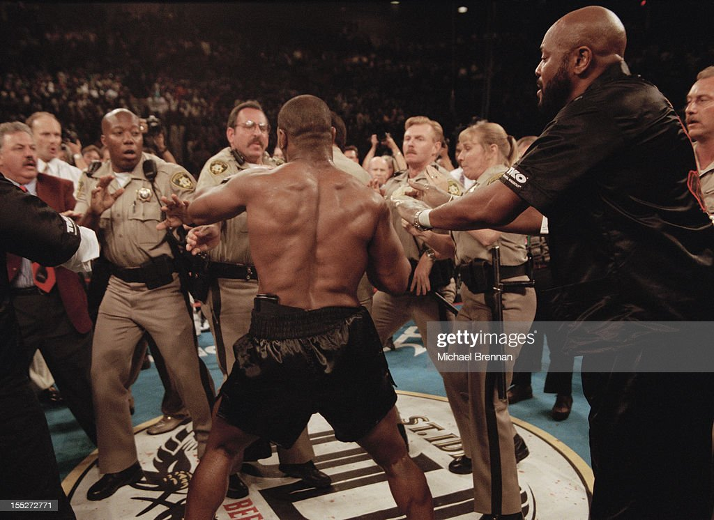 Police officers try to restrain American boxer Mike Tyson as he goes on a rampage after his fight against Evander Holyfield was stopped, Las Vegas, USA, 28th June 1997.