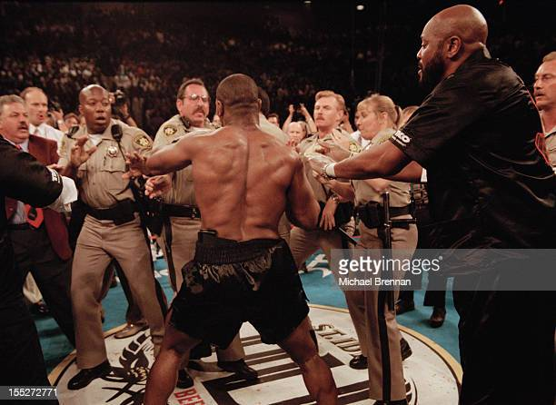 Police officers try to restrain American boxer Mike Tyson as he goes on a rampage after his fight against Evander Holyfield was stopped Las Vegas USA...