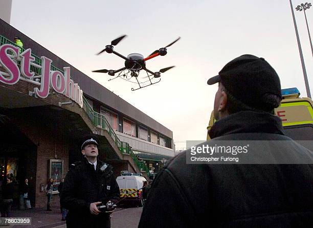 Police officers use a remote control drone fitted with a TV camera to help combat potential antisocial behaviour during traditional celebrations...