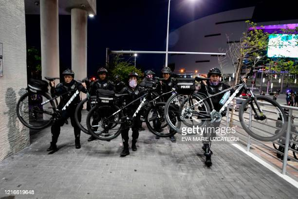Police officers use their bicycles to control the crowd during a demonstration in response to the recent death of George Floyd in police custody in...