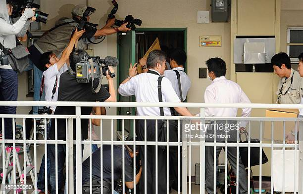Police officers visit the place linked to former Hyogo Prefecture assemblyman Ryutaro Nonomura on July 18 2014 in Osaka Japan Police start...