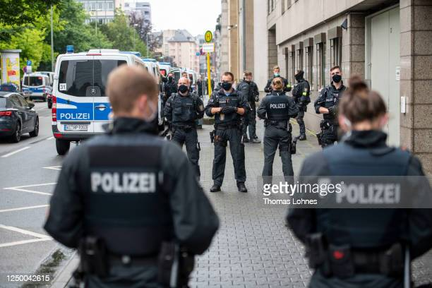 Police officers wait for the departure of Stefan Ernst who is accused of murdering politician Walter Luebcke and Walter H after the first day of the...