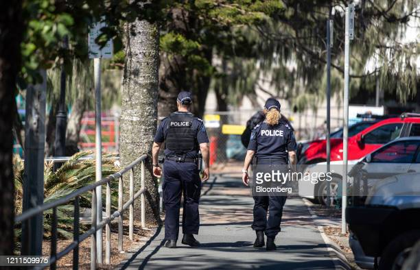 Police officers walk along the esplanade at Mooloolaba Beach in Mooloolaba, Australia, on Saturday, May 2, 2020. Australia's Prime MinisterScott...