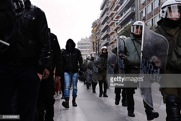 Police officers walk alongside the march in the center of Thessaloniki Hundreds of students demonstrated today in the center of Thessaloniki in...