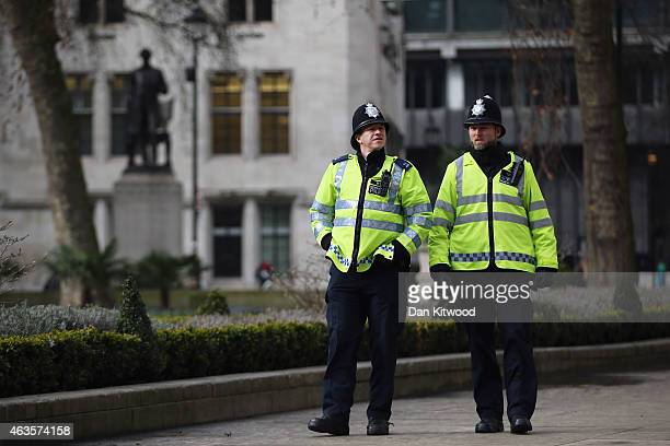 Police Officers walk around Parliament Square on February 15 2015 in London England