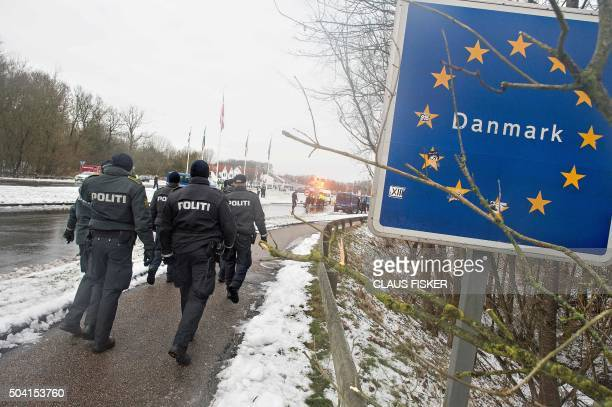 Police officers walk at the DanishGerman border on January 9 2016 in Krusaa Denmark January 9 2015 / AFP / Scanpix Denmark AND Scanpix / Claus Fisker...