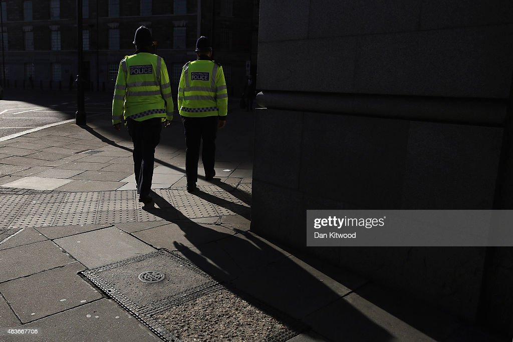 Police Officers walk down Millbank on February 17, 2015 in London, England.