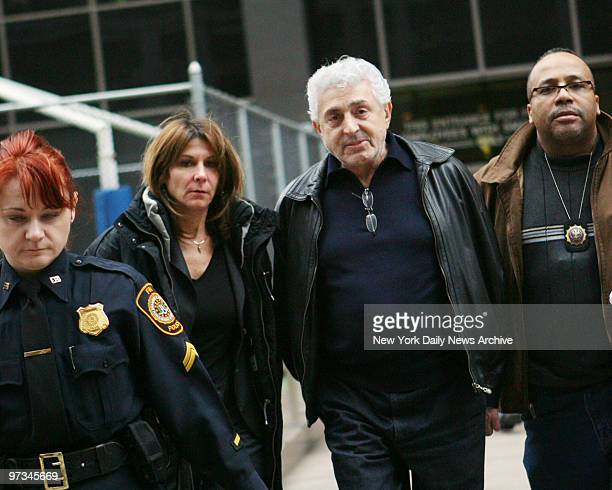 Police officers walk John D'Amico from the FBI's New York Field Office at 26 Federal Plaza after the arrests of more than 60 mobsters here and in...