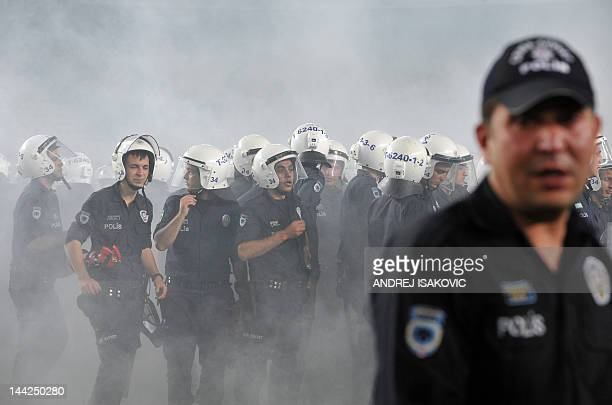 Police officers walk on the pitch during clashes with Fenerbahce's supporters after the Turkish Super League playoff final football match between...
