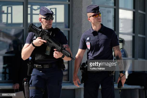 Police officers walk through the Le Bourget Airport during the 2017 Paris Air Show on June 19 in Paris France